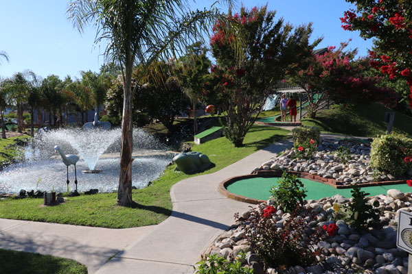 Photo of water fountain and mini golf course