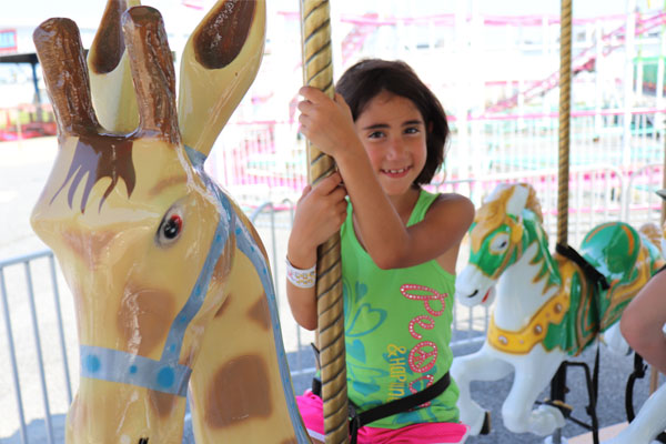 Young Girl on Carousel