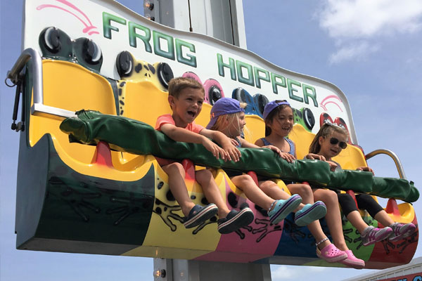 Kids enjoying frog hopper ride
